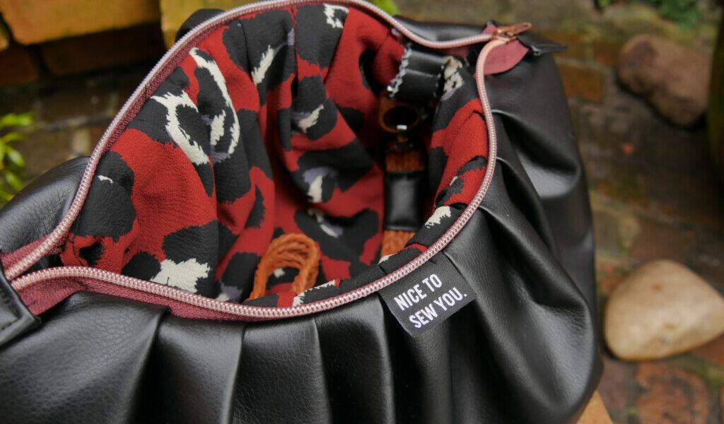PuffyBag Milliblus Stoffe Hemmers mit Gurtband Reißverschluss